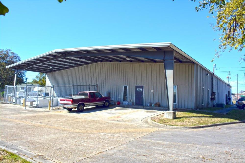 large metal maintenance building with truck sitting in front